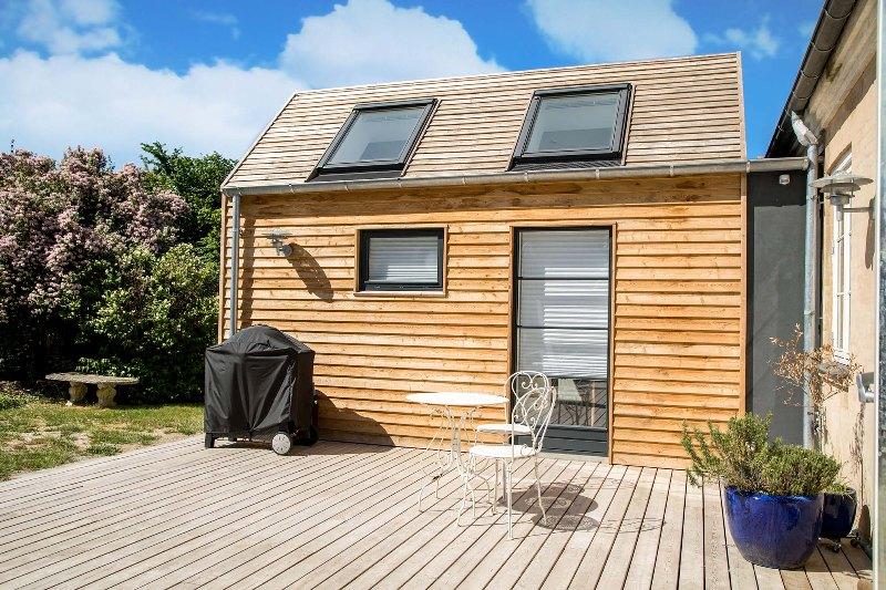 Tilbygning med træ på taget - Arkinaut Arkitekt- og Byggerådgivning Aps 1