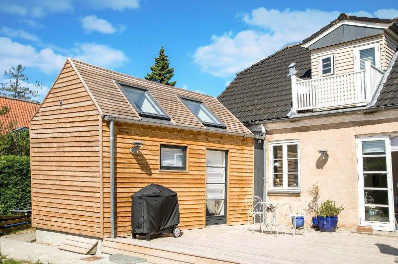 Tilbygning med træ på taget - Arkinaut Arkitekt- og Byggerådgivning Aps 3